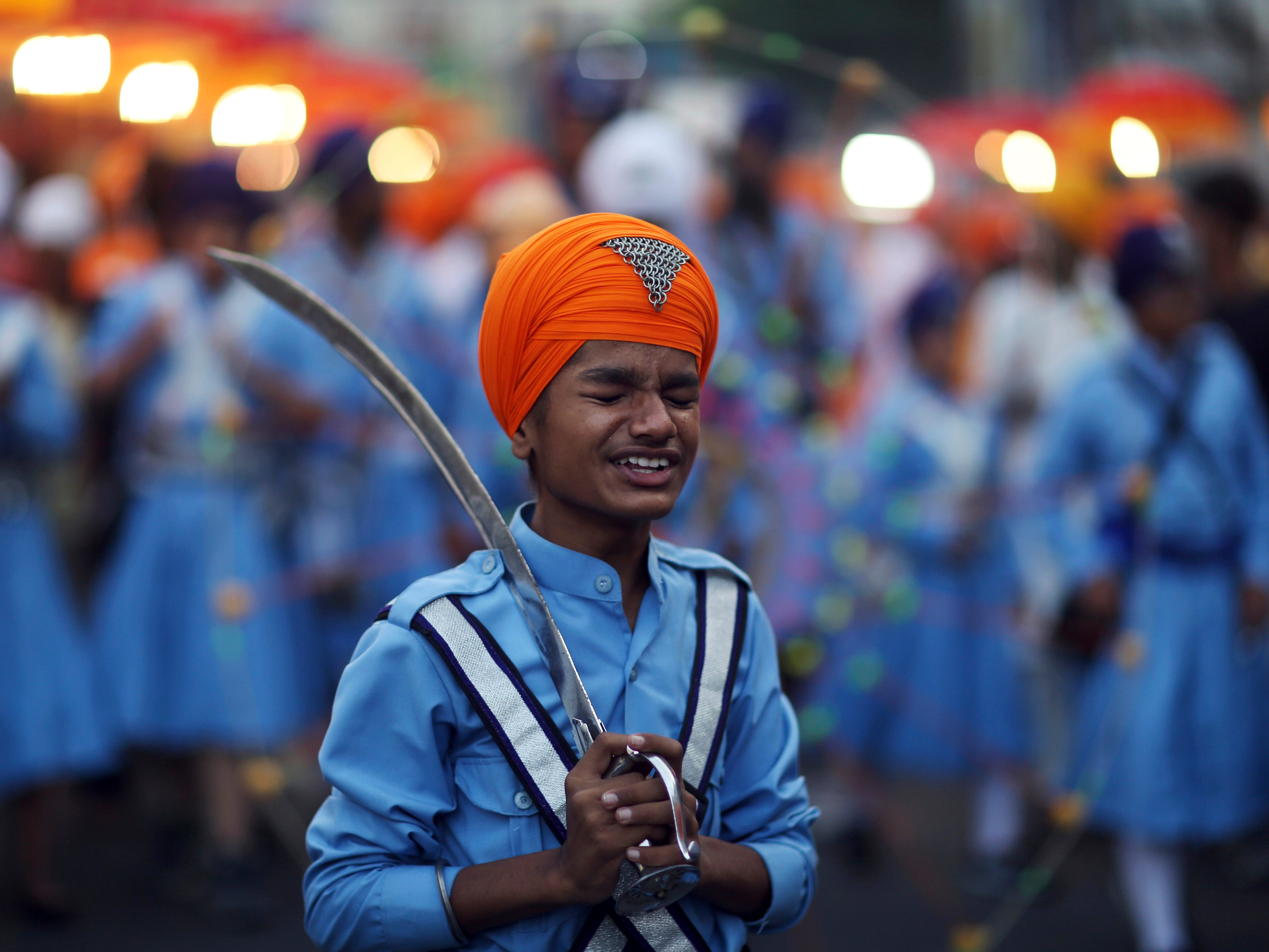 A Sikh boy reacts to a jovial comment from another as he prepares to display his martial art skills during a religious procession ahead of the birth anniversary of the first Sikh guru, Guru Nanak, in Hyderabad, India, Monday, Nov. 19, 2018. The birth anniversary of Guru Nanak will be marked on Nov. 23.