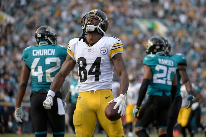 Pittsburgh Steelers wide receiver Antonio Brown (84) reacts after catching a pass in front of Jacksonville Jaguars cornerback Jalen Ramsey (20) for a 25-yard gain during the second half.