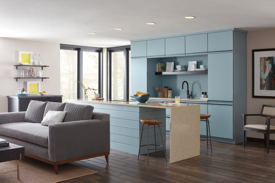 Blue tones and mixed finishes are king in cabinetry now.