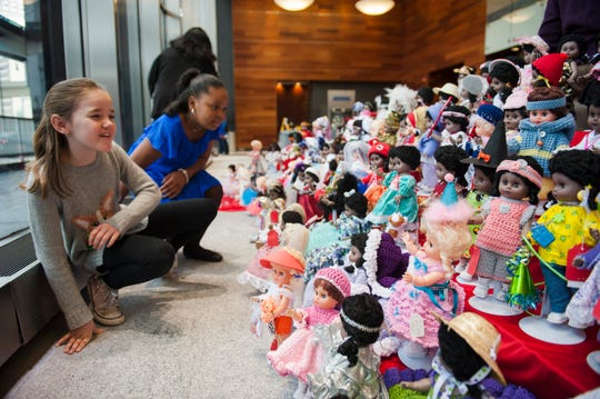 Judges Emily Stanczak, left, 9, of Auburn Hills and Amaria Clark, 10, of Redford carefully consider their choices from an array of fancifully dressed dolls during the annual judging of the Goodfellows doll-dressing competition at Comerica Bank in downtown Detroit on Monday, Nov. 19, 2018. Hundreds of volunteers dress the thousands of dolls that will be distributed to little girls from poor families in Detroit and nearby cities.