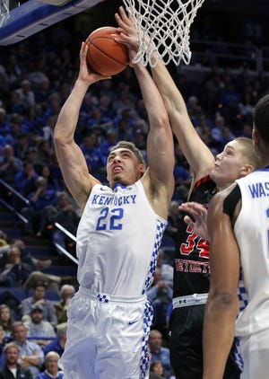 Kentucky's Reid Travis (22) shoots while defended by Virginia Military's Jake Stephens (34) during the first half.