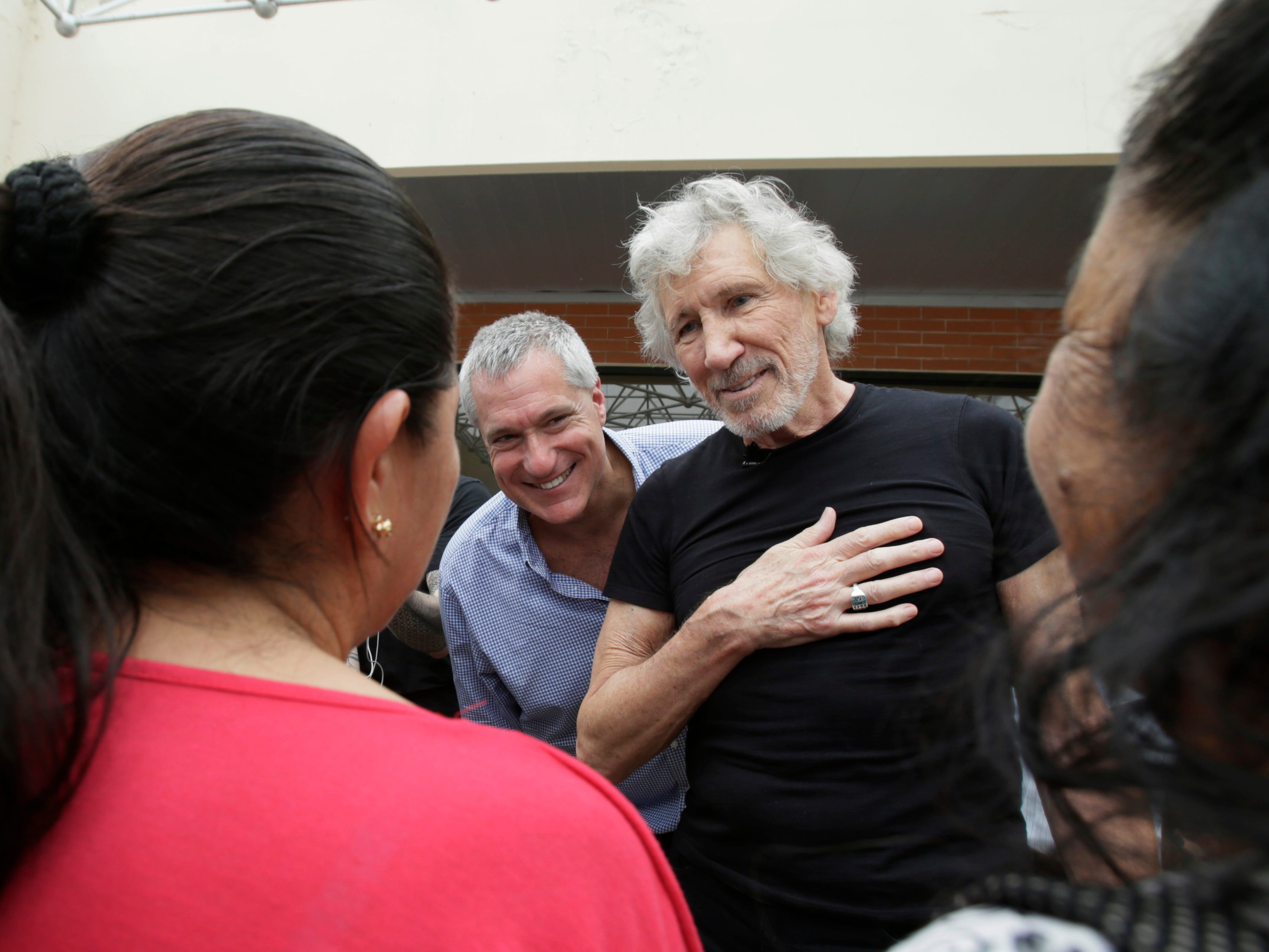 Musician and activist Roger Waters is welcomed upon arrival to Lago Agrio's airport by residents affected by oil extraction in Lago Agrio, Ecuador, Monday, Nov. 19, 2018. Ecuadoreans tried to get Chevron to pay for environmental damage caused to a rainforest by Texaco during its operation of an oil consortium from 1972 to 1990, and were ultimately successful in Ecuador where a court there ordered Chevron to pay $9.5 billion. But in 2014, a judge in New York invalidated the Ecuador judgment, deeming it was obtained through legal malpractice.
