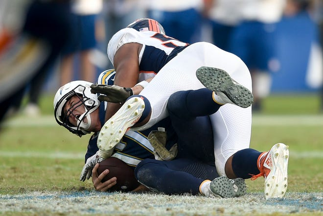 Los Angeles Chargers quarterback Philip Rivers gets sacked by Denver Broncos outside linebacker Bradley Chubb during the second half.