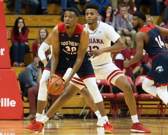 Josh Price is guarded by Indiana's Juwan Morgan during a preseason exhibition.