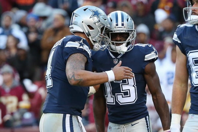 Oct 21, 2018; Landover, MD, USA; Dallas Cowboys quarterback Dak Prescott (4) celebrates with Cowboys wide receiver Michael Gallup (13) after combining on a touchdown against the Washington Redskins in the second quarter at FedEx Field. Mandatory Credit: Geoff Burke-USA TODAY Sports