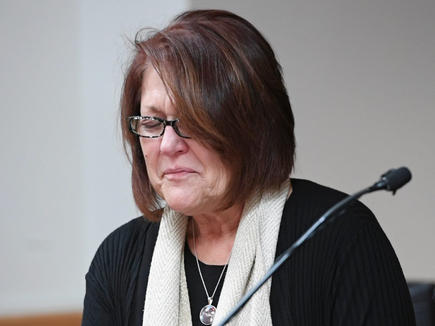 Cindy Watts gets emotional after addressing the court during her son's sentencing at the Weld County Courthouse on Monday, Nov. 19, 2018 in Greeley, Colo. Christopher Watts received three consecutive life sentences without a chance at parole on Monday, nearly two weeks after pleading guilty to avoid the death penalty. (RJ Sangosti/The Denver Post via AP, Pool)