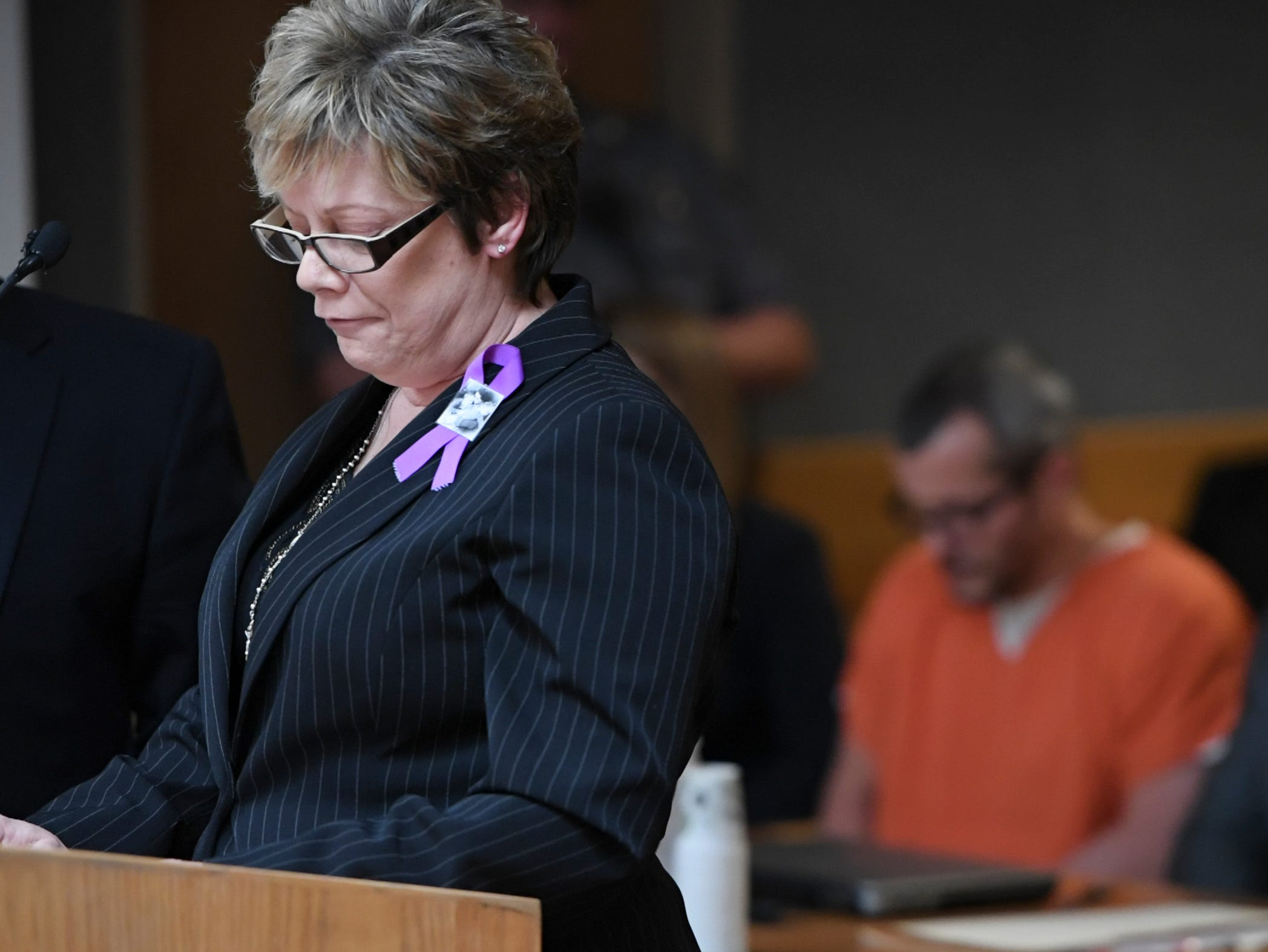 Sandra Onorati Rzucek, the mother of Shanann Watts, reads a statement during court at the Weld County Courthouse on Monday, Nov. 19, 2018 in Greeley, Colo. Christopher Watts received three consecutive life sentences without a chance at parole on Monday, nearly two weeks after pleading guilty to avoid the death penalty. (RJ Sangosti/The Denver Post via AP, Pool)