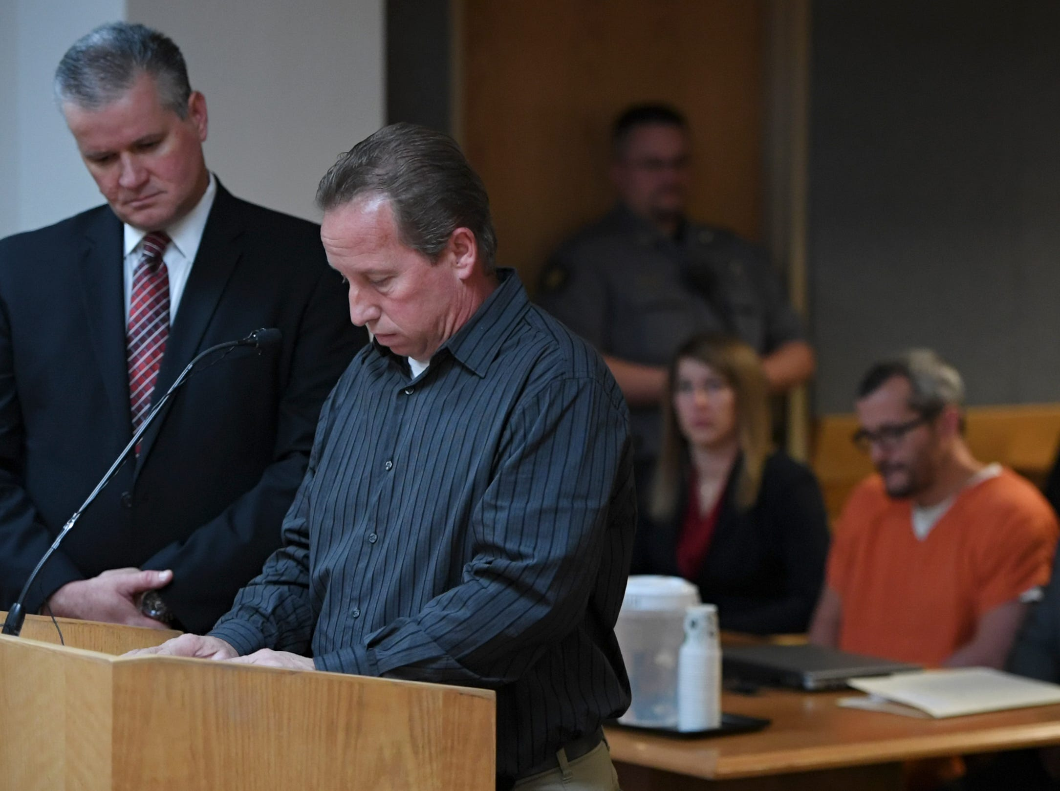 GREELEY CO - NOVEMBER 19: Michael J. Rourke, Weld County District Attorney, left, stands with Frank Rzucek, the father of Shanann Watts, as he reads a statement during court at the Weld County Courthouse on November 19, 2018 in Greeley, Colorado. Christopher Watts was sentenced to life in prison for murdering his pregnant wife, daughters. (Photo by RJ Sangosti/The Denver Post)