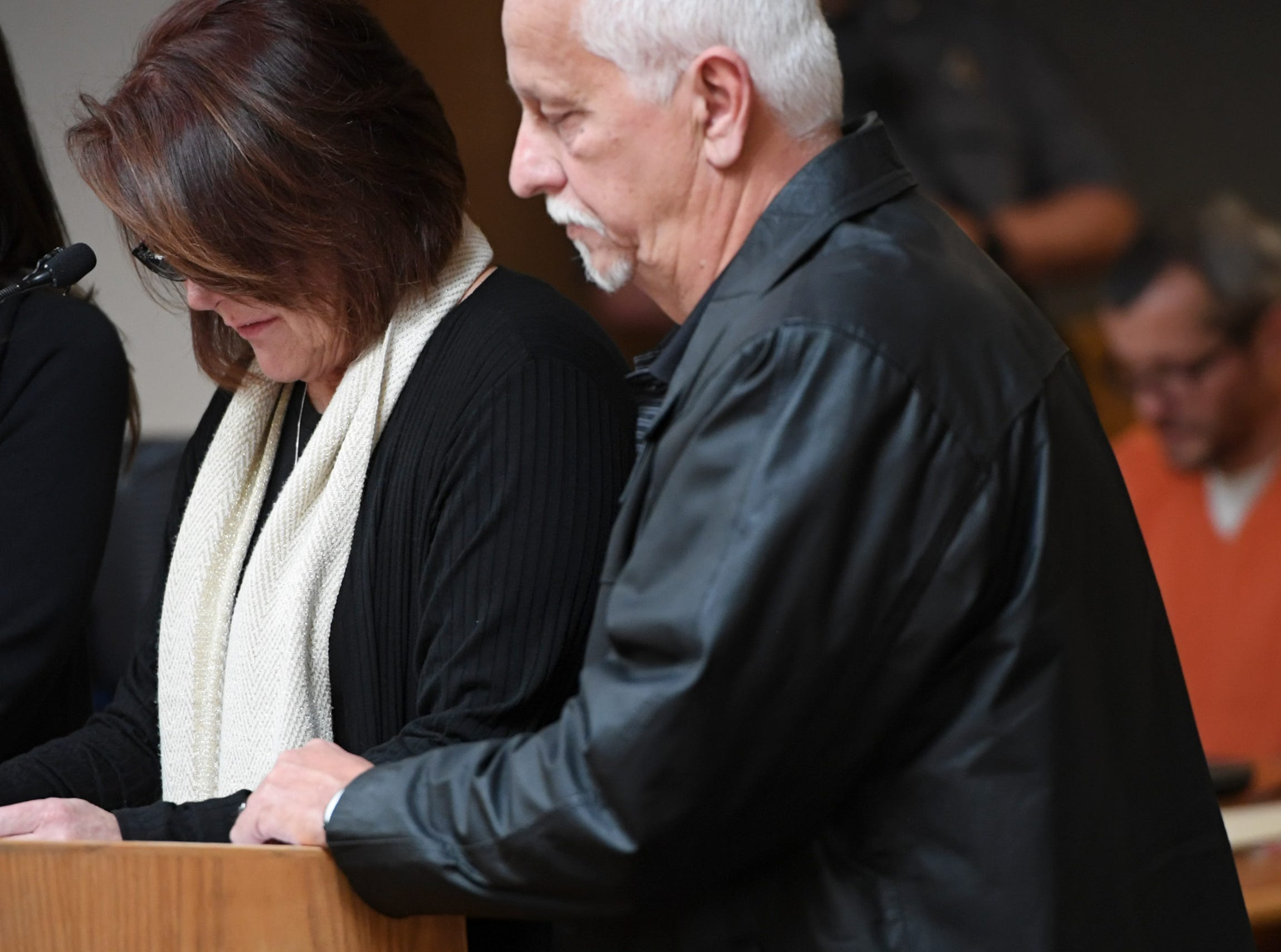Ronnie and Cindy Watts address the court during their son's sentencing at the Weld County Courthouse on Monday, Nov. 19, 2018 in Greeley, Colo. Christopher Watts received three consecutive life sentences without a chance at parole on Monday, nearly two weeks after pleading guilty to avoid the death penalty. (RJ Sangosti/The Denver Post via AP, Pool)