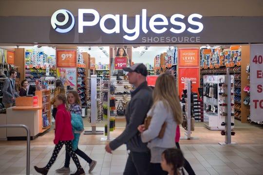 People pass in front of Payless Shoesource at Foothills Mall on Friday, November 16, 2018.