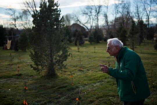 John Windsor shows one of the fields of various evergreen tree on his and his wife's property on Friday, Nov. 16, 2018, at Windsors' Christmas Trees in Windsor, Colo.