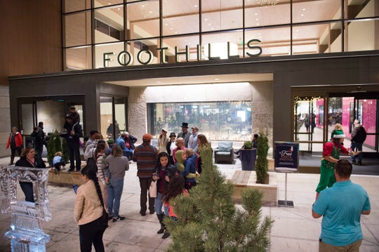 Crowds wander around the stores at Foothills Mall on Friday, November 16, 2018.