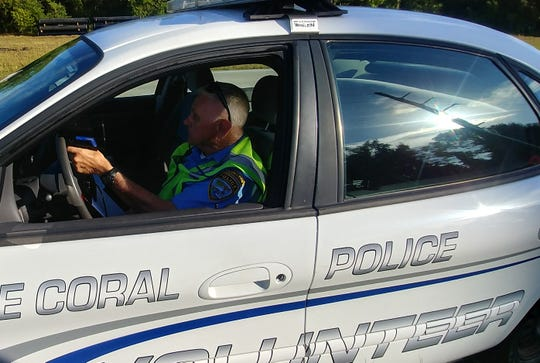 Cape Coral police volunteer Mike Mullen Sr. checks speeds with a radar gun in a construction zone.