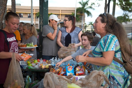 Housed and homeless come together at Lions Park in Fort Myers for a Saturday Thanksgiving feed organized by Jack Frost and People Helping People of Southwest Florida.