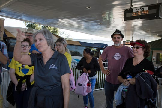 """This way to Solomon Boulevard?"" Lee County Homeless Coalition director Janet Bartos leads participants from the bus terminal to Salvation Army about 20 blocks away during Saturday's Homeless Challenge."