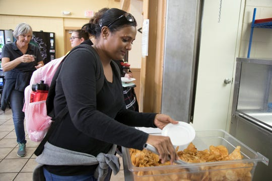 Homeless Challenge participant Sasha Ammersingh samples homemade potato  chips in the cafeteria of Salvation Army's Fort Myers base on Saturday.