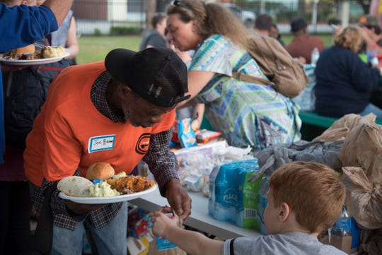 The homeless and the housed come together at Fort Myers' Lions Park on Saturday for a free Thanksgiving dinner made possible by Jack Frost and People Helping People of Southwest Florida.
