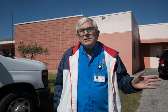 Salvation Army social worker Butch Poole talks to Homeless Challenge participants on Saturday about the Bob Janes Triage Center, which gives 58 people a jail diversion bed, a case worker and 30 days to start a better future.