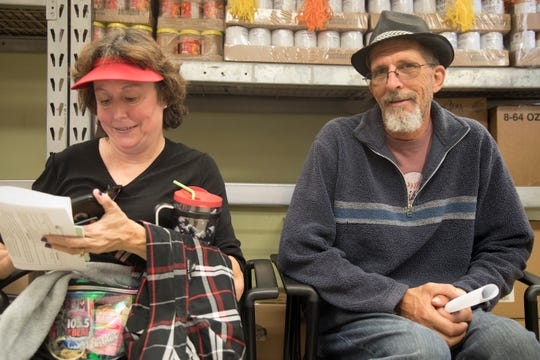 Jeff and Kerrie Meyers cool their heels for a minute at the Community Cooperative food pantry during Saturday's Homeless Challenge, a walk-in-their-shoes taste of what it's like to be homeless. Jeff knows only too well from 10 years on Charlotte County streets. Today he owns a home and has a full-time job. The couple married in June of 2017.