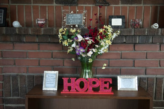 The mantle in the Big House at SalusCare in Fort Myers is lovingly decorated by six women in recovery who live there.