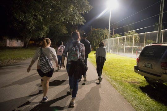 Homeless Challenge participants leave Fort Myers' Lions Park on Saturday night bound for another homeless waypoint, Centennial Park downtown.