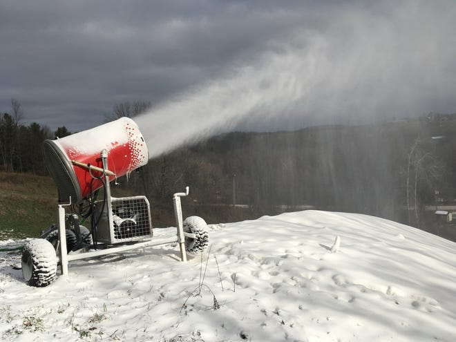 A snow gun puts down snow for the ski, snowboard and tubing hills at Winter Park in Kewaunee.