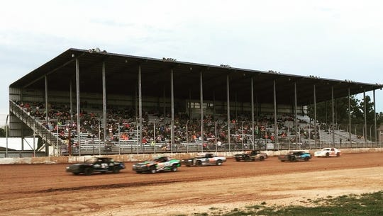 Race cars in the Street Stock class zoom past the grandstand at Luxemburg Speedway. Ashley Stevens and Skyhigh Entertainment, LLC, were named promoters for the 2019  racing season at the third-mile track at the Kewaunee County Fairgrounds.