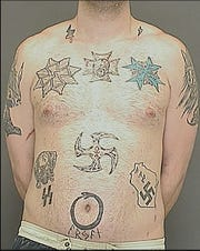 Michael T. Anderson had multiple Nazi and white supremacist tattoos when he was booked into the Brown County Jail in 2012 for battery and disorderly conduct. A condition of his sentence was to have no contact with the Aryan Nation.