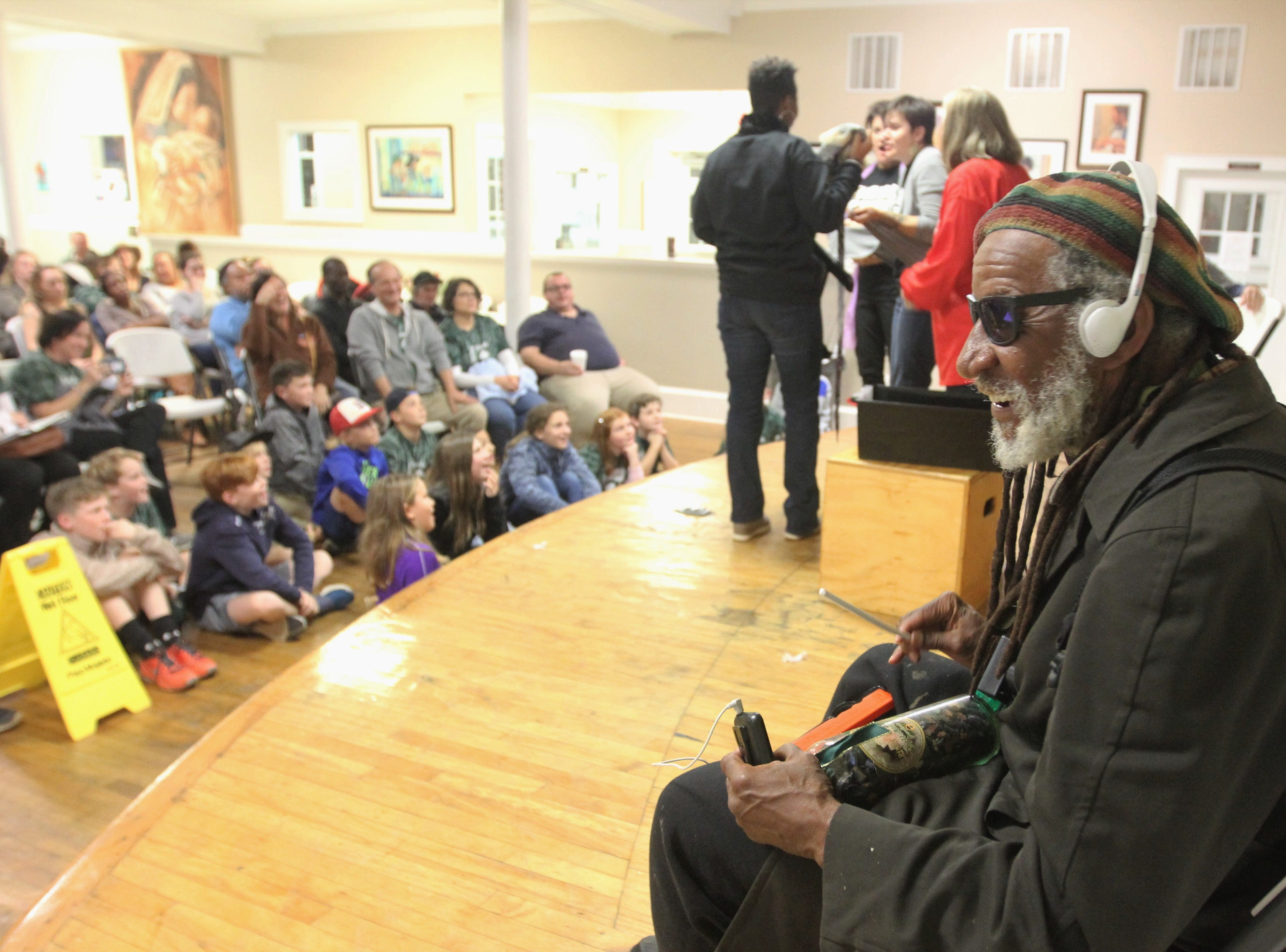 Mr. Earl Grant plays percussion for a group of performers who re-enact stories told by audience members, especially the homeless who come there at Triune Mercy Center.