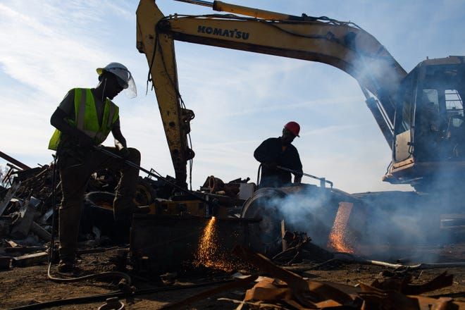Workers break down reusable metal products at Adams Scrap Recycling on Monday, Nov. 19, 2018.