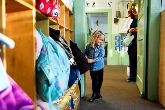 Olivia Richardson, 3, drops off her backpack and coat in her classroom at the Haynsworth School on Monday, Nov. 19, 2018.