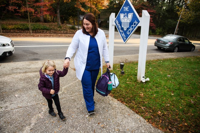 Kate Richardson walks her 3-year-old daughter Olivia to daycare at the Haynsworth School on Monday, Nov. 19, 2018.