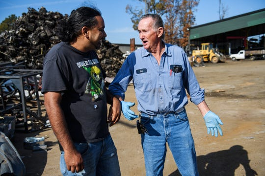 Rajesh Desor, left, speaks with Earl Gentry after he dropped off scrap metal at Adams Scrap Recycling on Monday, Nov. 19, 2018.