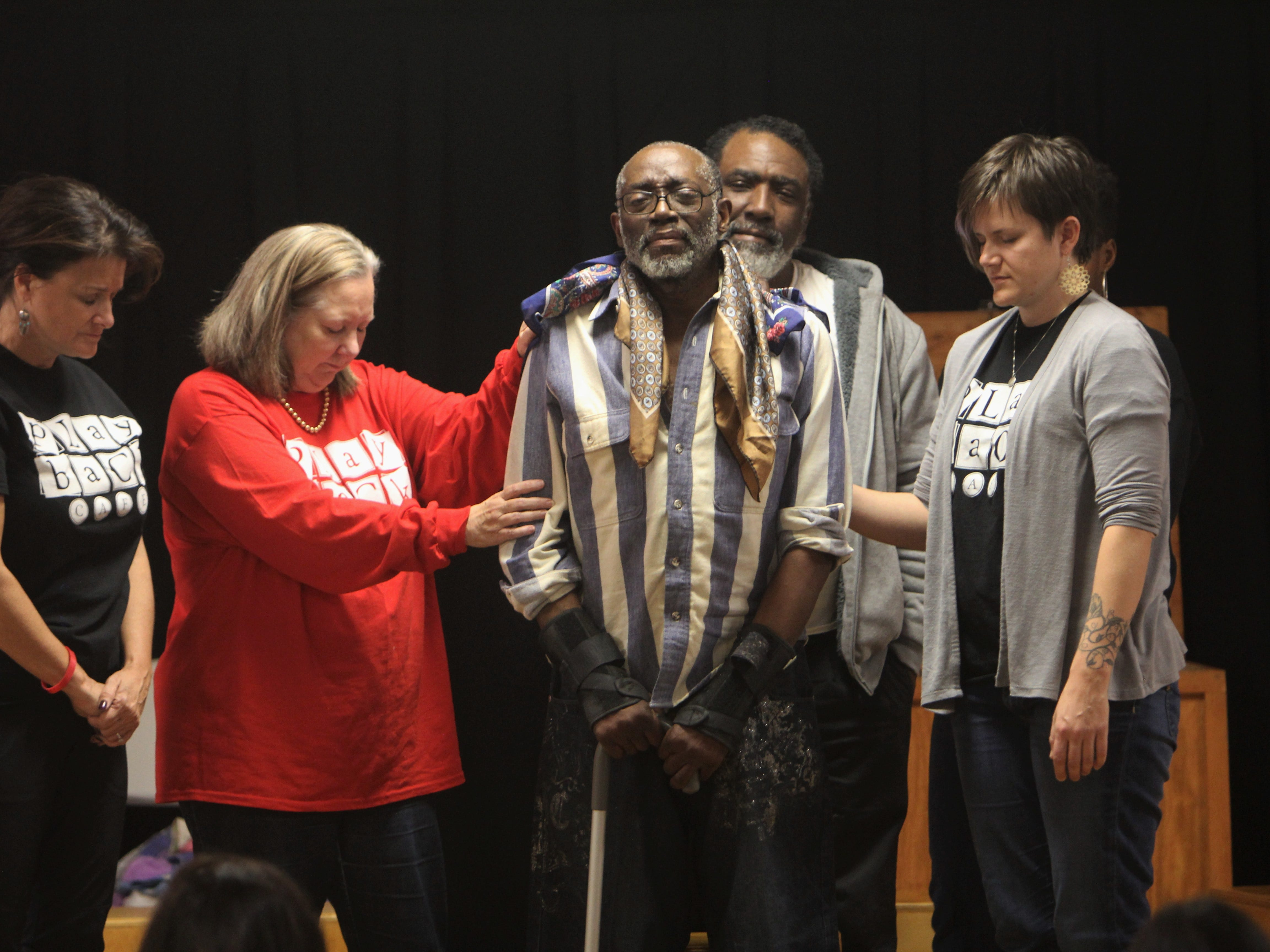 John Fuller, center, has been getting help, and helping people, at Triune Mercy Center in Greenville for 18 years. He said he is the number one fan of the Playback Cafe actors who listen to stories from homeless people and retell those stories immediately back.