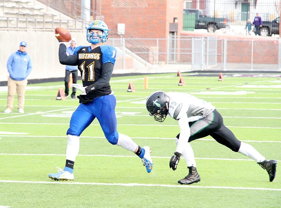 Noah Ambuehl fires a pass.