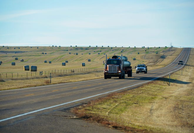 A truck loaded with pipe for the Keystone XL Pipeline project rumbles down the highway between Fort Peck and Glasgow the last week of October, a week before a court ruling halted construction activity.