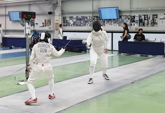 Jane Dorian, foreground, competes in the Woman's Foil on November 18, 2018, at the Australian Open Fencing Competition held in Melbourne, Australia. Dorian finished 34th out of 34 competitors in the individual competition, but did defeat her Australian opponent 15-12 in the first round of eliminations. She lost in the second round of eliminations.