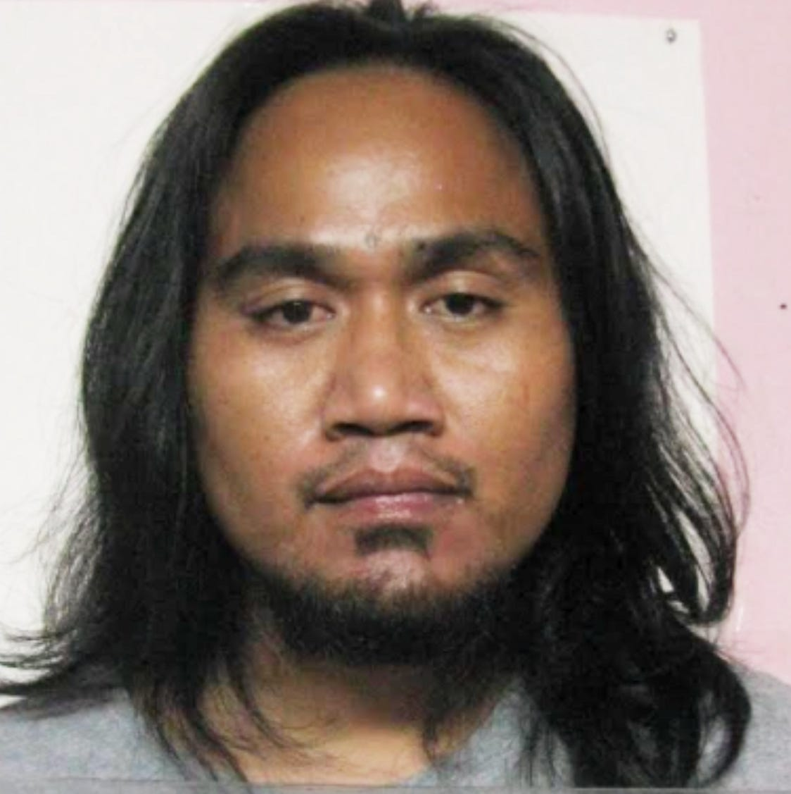 Bayo Likity charged in court, allegedly peed on the floor at the Micronesia Mall