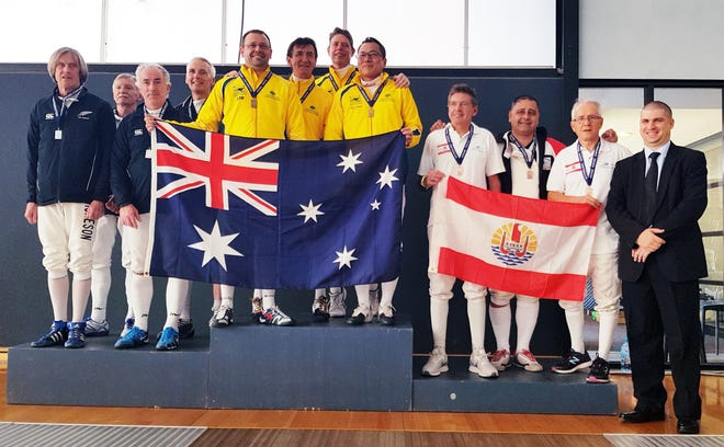 Guam fencer Anthony R. Camacho wins a bronze medal at the Oceania Fencing Confederation's Veteran's Championships held in Melbourne, Australia on Nov. 18. Camacho, center on the bronze podium with Tahiti, medaled in his first-ever international competition with only three weeks to prepare. New Zealand won the silver and Australia, the Bronze.