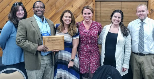 Several Hendersonians recently accepted a special citation for planning of The Perch pocket park in downtown Henderson. Accepting on behalf of the various groups and individuals involved were Hendersonians Dawn Kelsey, Trace Stevens, Missy Vanderpool, Lindsay Locasto, Abby Dixon and Brad Staton.