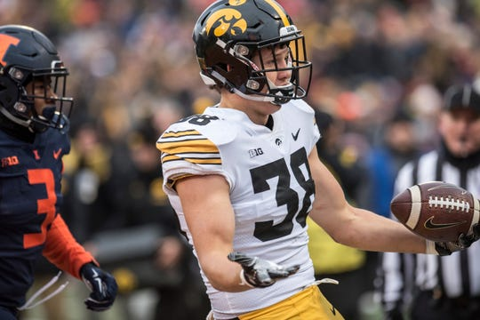 Iowa's T.J. Hockenson scored touchdowns on both of his receptions at Illinois, this one on a 37-yarder in a 63-0 win.