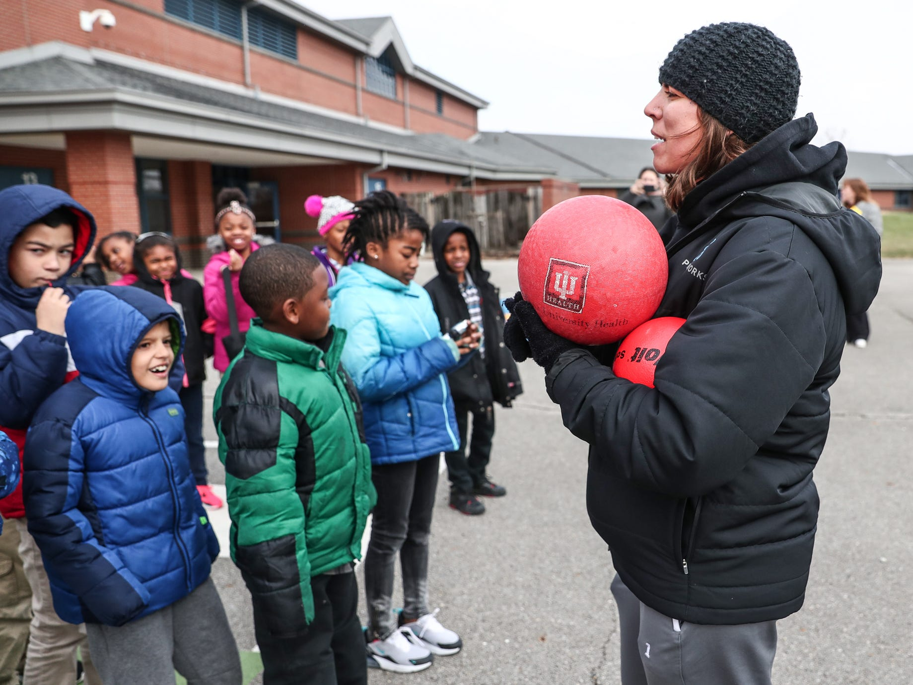 Playworks Coach Bailey Smith gathers a group of Sunny Heights Elementary School third graders during recess on Friday, Nov. 16, 2018. Playworks, as well as partners Jump IN for Healthy Kids, aims to keep kids healthy and active.