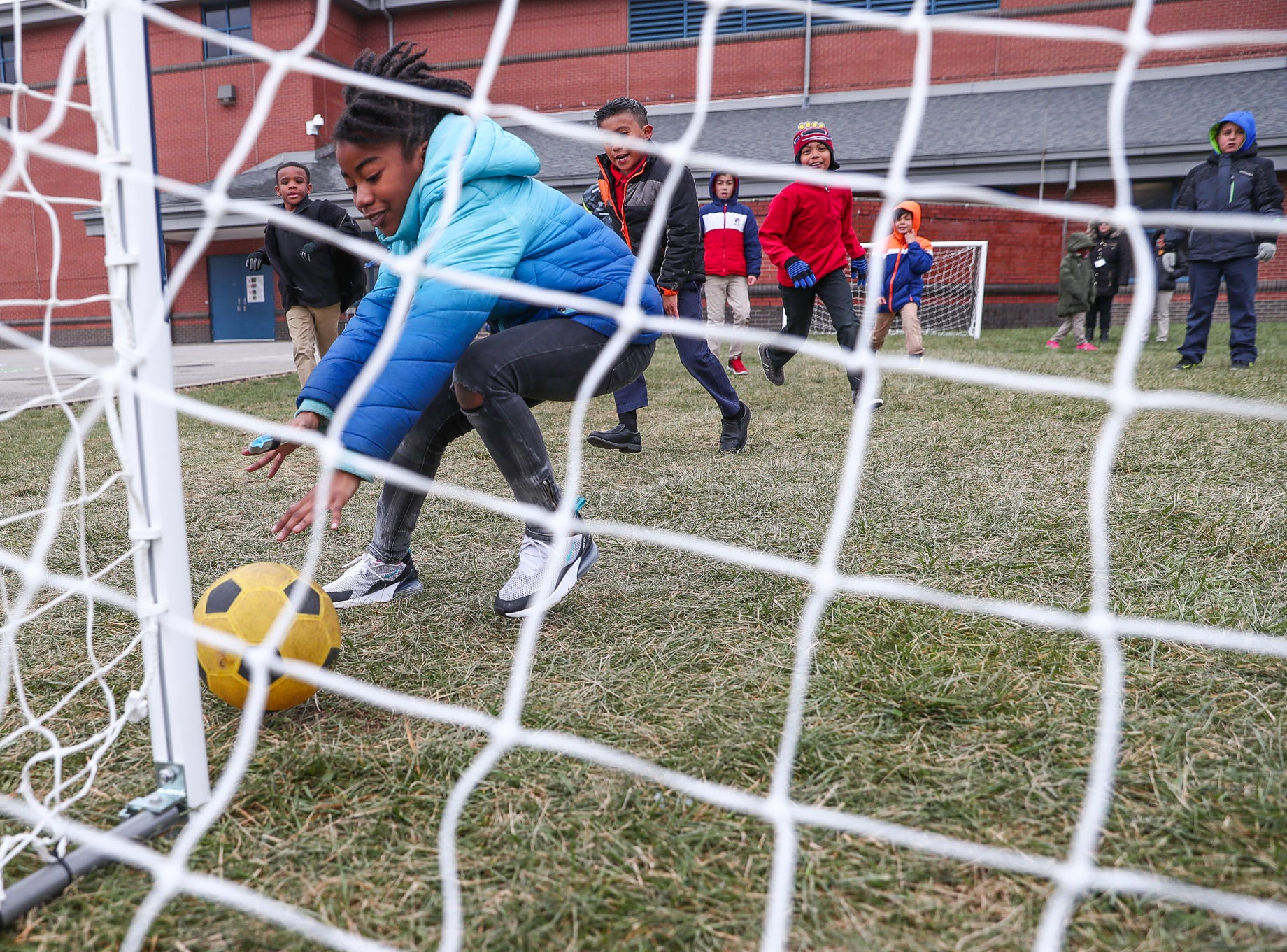 Ja'kiya Alvies, 8, plays goalie during a game of soccer at Sunny Heights Elementary School on Friday, Nov. 16, 2018.