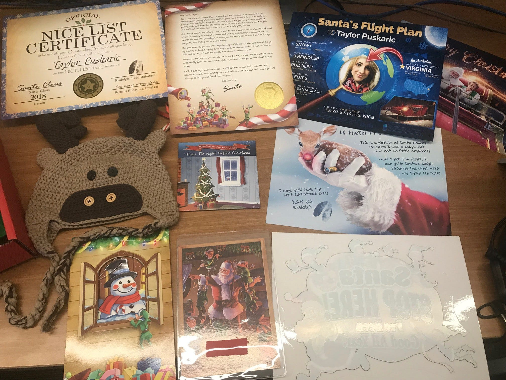 Closeup of the Platinum Package items. Includes nice list certificate, letter from Santa, flight plan, Merry Christmas picture, reindeer hat, video from Santa, reindeer picture, Christmas card, clipping of Santa's suit, and window decal.