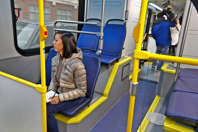 IndyStar reporter Kellie Hwang takes notes as she takes a ride on an electric IndyGo bus that will eventually drive the Red Line, Monday, Nov. 19, 2018.  When it opens in the Fall of 2019, the Red Line will be Indy's first rapid transit line and the country's first all-electric rapid transit line.