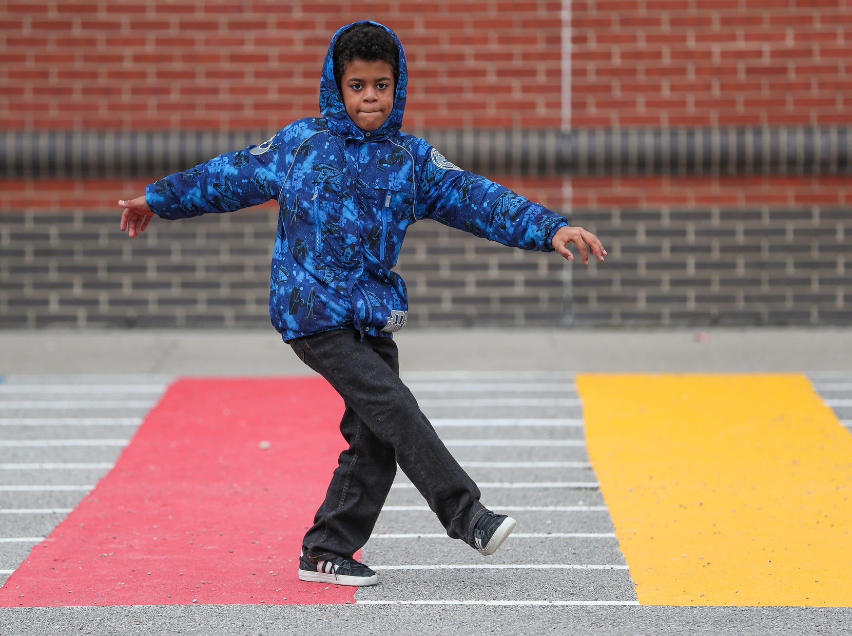 Ethan Price, 9, dances during recess at Sunny Heights Elementary School on Friday, Nov. 16, 2018. Instead of allowing kids to stand around, the school brings in Jump IN for Healthy Kids and their partner, Playworks, to keep kids active.