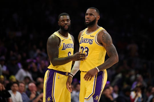 TO A HEART-TO-HEART MOMENT... Lance and Lebron talked during their game aganst the Denver Nuggets at Staples Center.