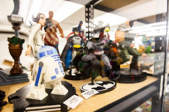 An R2-D2, Princess Leia and Batman statue are seen amongst other merchandise on display on Sunday, Nov. 18, 2018, inside Daydreams Dungeon in the basement of 115 S. Linn St. in Iowa City. The store is open on Sunday, 1-5 p.m.