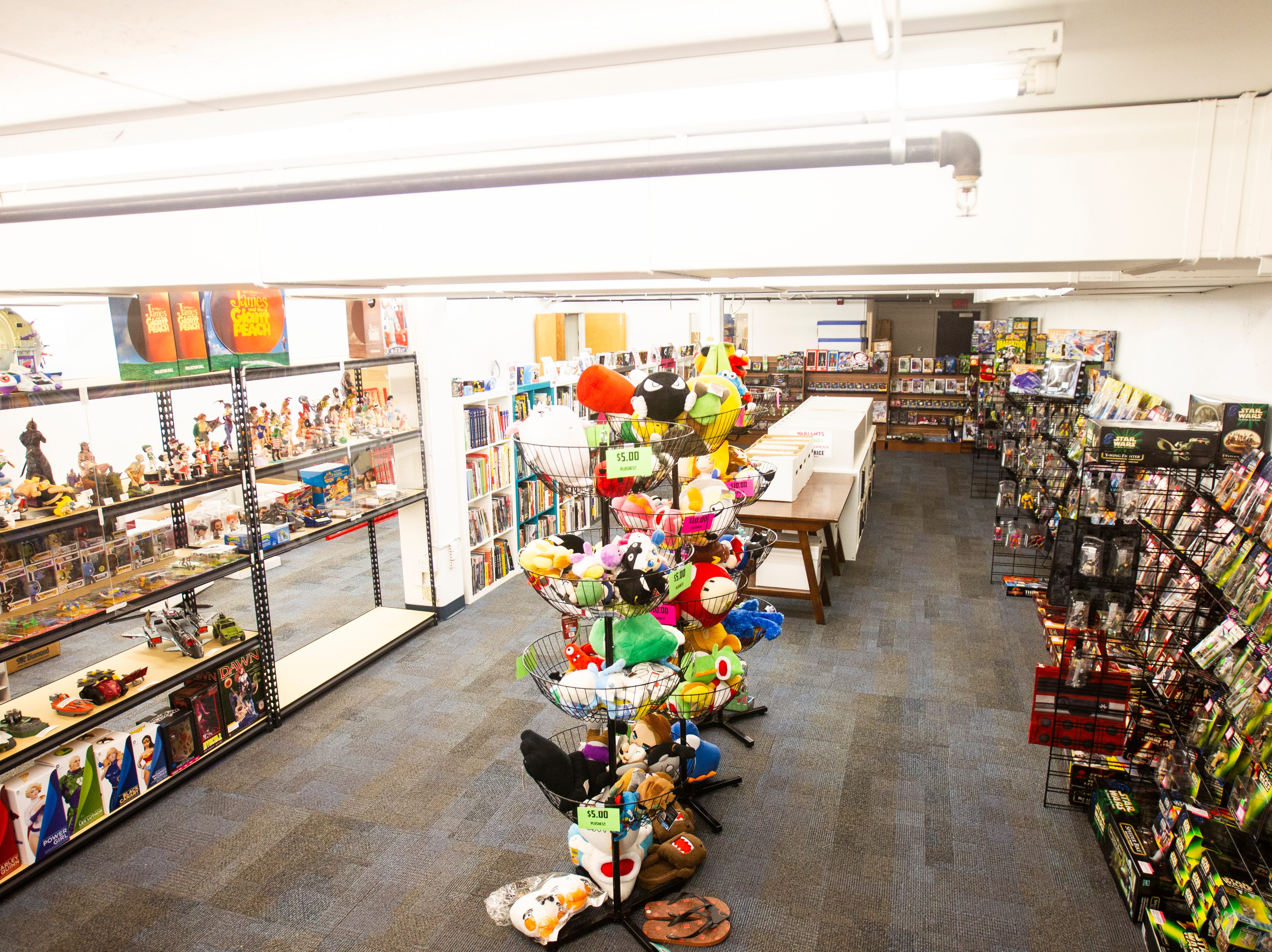 Merchandise is displayed on Sunday, Nov. 18, 2018, inside Daydreams Dungeon in the basement of 115 S. Linn St. in Iowa City. Daydreams Comics owner Zach Power also operates the Dungeon.