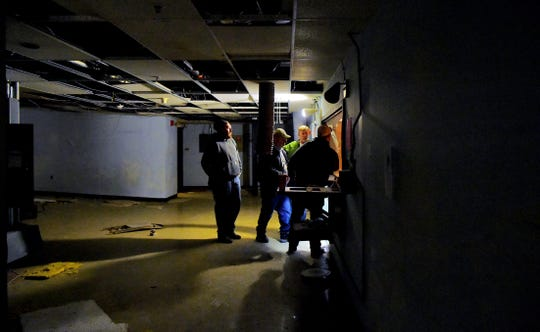 Construction crews on Nov. 15 renovate the former movie theater of The Shops at Ithaca Mall to accommodate the new permanent home of Running To Places Theatre Company.